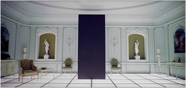 ...The monolith in 2001, A Space Odyssey which in a way is transmitting the knowledge of an advanced civilization, helping the progress of mankind