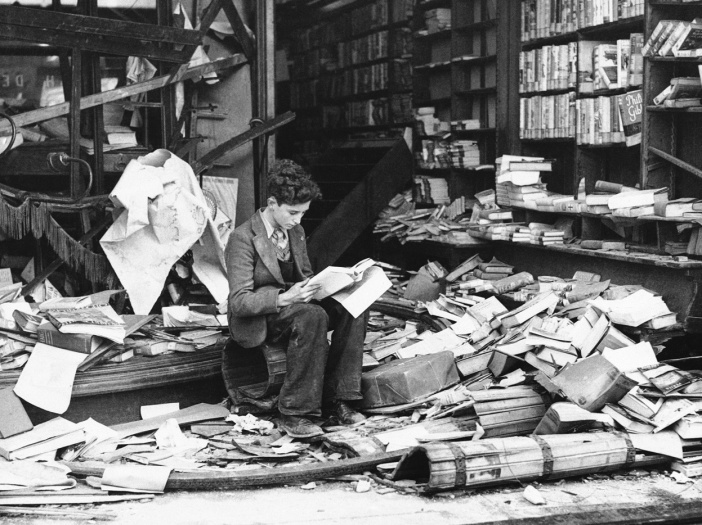 25-A-young-boy-sits-amidst-the-ruins-of-a-London-bookshop-following-an-air-raid-Oct-8-1940-01